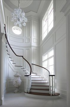 Unbelievable white entry foyer and curved staircase, fabulous trim. Maybe change the floor color n the wall for my entry n stairs Curved Staircase, Grand Staircase, Staircase Design, Staircase Ideas, White Staircase, Spiral Staircases, Staircase Molding, Modern Staircase, House Staircase