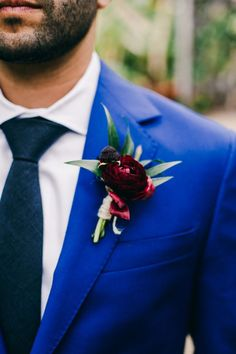 Stunning blue suit and crimson boutonniere | Image by Hannah Costello