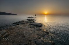 """First light - This is a shot from beautiful Andros island in Greece. During my last visit there i had the opportunity to wake up in the morning and visit this amazing place with the famous lighthouse called Tourlitis  Visit my: <a href=""""https://www.facebook.com/tasoskphotography""""> FB Page </a> - <a href=""""https://twitter.com/Tasko83""""> Twitter  </a> - <a href=""""https://plus.google.com/106699010166117105623/posts"""">Google+</a> © Copyright Tasos Koutsiaftis. No usage permitted without prior…"""