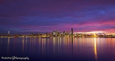 Seattle at dawn across Elliot Bay by Thatcher Kelley Photography