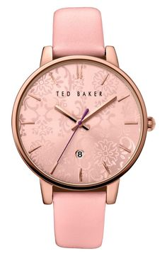 Adoring this pink leather watch with a floral etched dial. This darling accessory will add a whimsical touch to any ensemble.