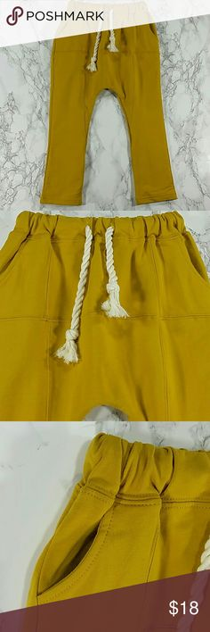 Mustard Sweatpants. Kids Adorable sweatpants in mustard color.  Have pockets Pull up style.  This item is brand new and never used. No tags. Bottoms Sweatpants & Joggers
