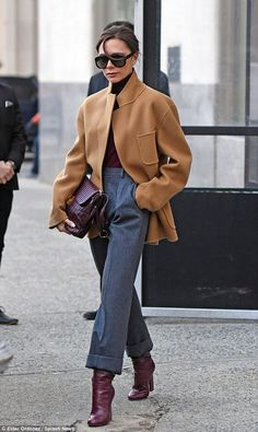 Victoria Beckham wearing Victoria Beckham Quinton Bag, Victoria Beckham Heel Boot, Victoria Beckham Whistle Keyring, Victoria Beckham Wool Jacket With Cashmere, Victoria Beckham Power Frame Sunglasses and Victoria Beckham Long Sleeve Polo Neck Top in Ochre