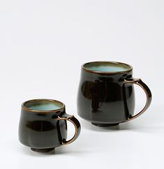 Ceramics by Chris Keenan at Studiopottery.co.uk - 2012. Tenmoku and celadon cups. Height 55mm and 90mm.