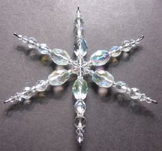 Beaded Snowflake Ornament - 3 http://www.ecrafty.com/casearch.aspx?SearchTerm=snowflake