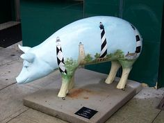 # 16 of the 2009 Pigs in the City 5, of Lexington, NC. (Pork BBQ Capital of the World). Was sponsored by Uptown Lexington, and the artist was Margaret Sink. It was located on S. Main St. in front of Cafe' 35.