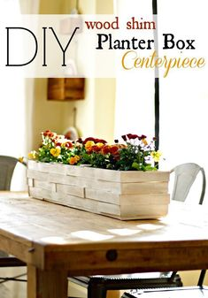 Make a gorgeous planter box for your table on the cheap using wood shims or paint stirrers. I love this as a simple fall centerpiece!