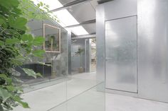 Image 10 of 20 from gallery of Work-Studio in a Plant-House / O-office Architects. Photograph by Liky Photos Building Skin, Metal Cladding, Glass Office, Concrete Stairs, Big Design, Timber House, House Built, Design Furniture, Design Firms