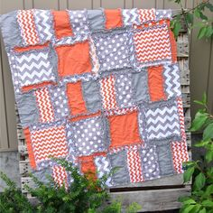 Custom handmade Rag quilt orange and gray baby crib quilt. The orange and Gray Crib Quilt: - All fabrics that are 100% Cotton - Made with modern designer quality chevron, solids, polka dot fabric prin