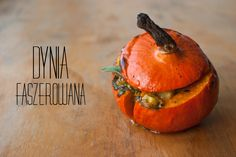 Baked pumpkin stuffed with potatoes and sage