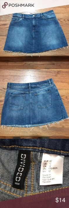 """H&M Frayed Jean Skirt Super Cute H&M frayed bottom skirt. It's in excellent condition! Great for summer with flip flops or great for winters with leggings and boots! Waist is 30"""" and it's 14.5"""" long Divided Skirts"""