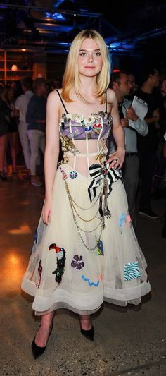 Elle Fanning in a sheer, corseted, intricately embellished crinoline dress from Marc Jacobs.