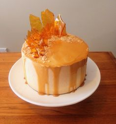 Caramel cake with butterscotch mousse filled layers with toffee shards #cake…