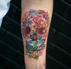 Skull tattoo designs have a variety of different meanings; the most common symbolic interpretation of a skull is the image of death and mortality. Floral Skull Tattoos, Skull Tattoo Flowers, Skull Girl Tattoo, Sugar Skull Tattoos, Skull Tattoo Design, Flower Skull, Flower Tattoos, Badass Tattoos, Arm Tattoos