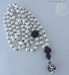108 Swarovski Pearls made with mantra and intention enhanced by a Sterling Silver Rudraksha Seed & Amethyst Pendant.