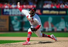 Jason Motte throws to a Washington Nationals batter during the eighth inning. Cards won the game 5-2. 6-15-14