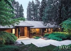 A Contemporary Medina Home on a Wooded Lot - lovely clean lines, natural finishes, minimalist feel as it nestles into the sylvan setting. So beautiful!