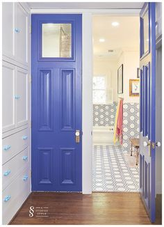 The blue doors...paired together they really are a statement. One opens to the bathroom, the other to a closet.