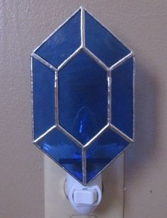 Hey, I found this really awesome Etsy listing at https://www.etsy.com/listing/208853443/blue-rupee-night-light-in-stained-glass