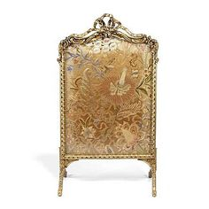 A French late 19th century gilt composition fire screen