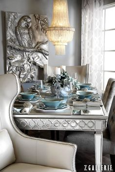 Together, soft pastel blues and stunning silvers create a embracing and elegant space.