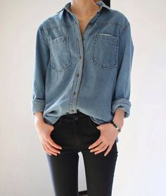 Denim shirt. Black jeans.: