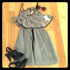 Cute Gray open back dress! Gray color and black trim. Features a chiffon feel, draped crop top, adjustable waistband, and window at the back. Will negotiate price. T.L.H. by Hype Dresses Backless