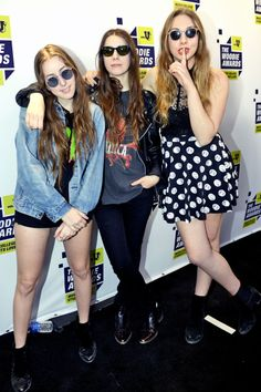 March 14, 2013 At the mtvU Woodie Awards in Austin, TX, the musicians flaunt their effortlessly edgy style, pairing casual ensembles with vintage-inspired sunglasses and boots.   Read more: HAIM Style - Fashion Pictures of HAIM - ELLE