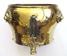 large-scaled Imperial Russian hand-hammered brass jardiniere with lion head mounts; Imperial Russia Stamp, City of Tula (in Cyrillic); the circular vessel with rolled lip above a portly body tapering to the foot; raised on 3 exhuberant paw feet c.19th C