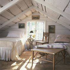 White painted beamed bedroom, raw floorboards, single bed, small attic, loft bedroom