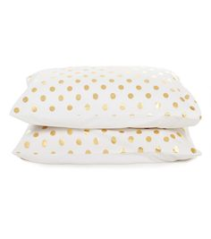 gorman // gold polka dotted pillow cases...