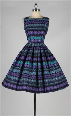 Vintage 1950s dress. Black floral print by millstreetvintage