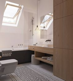 Bagno scandinavo in bianco e nero con vasca, doccia e pavimento in mosaico motivo geometrico