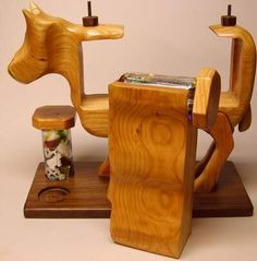 Remove the two knobs on the back of the cow and the kaleidoscope portion can slide out. The object chambers use oil to slow the tumbling of the stained, blown, and dichoic glass.