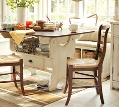 Like the table.  Also like the idea of putting a bench in front of the windows with lots of bright pillows.