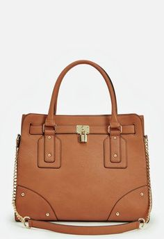 You'll love this lady-like faux leather bag with a minimal design and an adjustable shoulder strap....