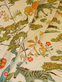 """Pattern Whimsical Safari color Multi  heavy premium tapestry upholstery fabric, fantasy jungle animal and floral theme  repeat 30"""" x 30"""" 58""""W  polyester backed for upholstery  from a warehouse buyout, discount clearance priced at only $22.95, regular price $49.00, by the yard, limited quantity, can not be reordered  #upholstery #tapestry #safari"""