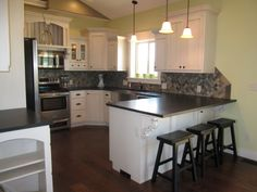 Thompson Kitchen White Cabinets With Absolute Black Leather Finish Texture Granite Frigidaire Liances