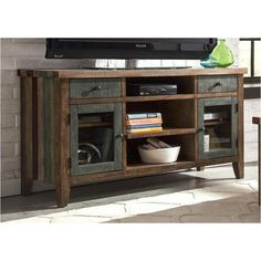 This media console will complete your living room space. Blending an array of rustic and more modern accents, and features drawer space, and shelving. Completed with a beautiful multi-colored finish, it will transform your home style for years to come.