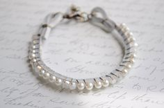 Lady in White-  Pearl and swarovski crystal wire wrapped bracelet on leather cord. $32.00, via Etsy.