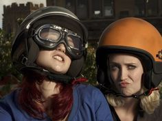 Naomi and Emily - stank faces as they roll up on their moped, so tough!