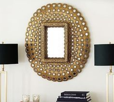I do like the idea of a peacock mirror because it sort of fits in with your more ethnic textiles.