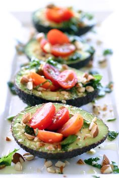 Took these to a party Sat night, and they were a hit!  Just an avocado half, filled with cut up tomatoes and cucumber chunks, a few slivered almonds, and tangy Italian dressing sprinkled over the top.  Gosh, it's good.