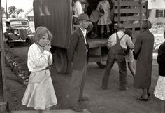 All Aboard the School Truck: October 1935. Red House, West Virginia. Youngsters on the way to school. 35mm negative by Ben Shahn for the Farm Security Administration.