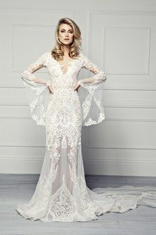 "<strong>Bell-Bottom Sleeves:</strong> <a href=""http://pallascouture.com/"">Pallas Couture</a>"