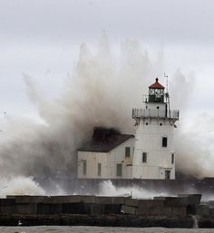 Waves pound a lighthouse on the shores of Lake Erie during Superstorm Sandy Oct. 30, 2012.