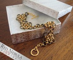 Hey, I found this really awesome Etsy listing at https://www.etsy.com/listing/170044515/chainmaille-flower-bracelet-gold-plated