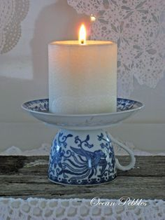 Vintage Tea Cup Candle Holder.. This is like one of my palm candles.. Gorgeous. Really shows the candle off nicely.