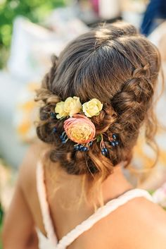 Pretty updo with flowers.