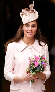 Pretty in pink! The Duchess wore one of her favorite milliners Jane Taylor once again for an official engagement in March 2015. <br>Photo: Getty Images